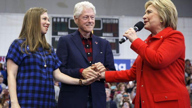 Hillary Clinton is joined by her husband, former President Bill Clinton, and their daughter, Chelsea, during a campaign event earlier this year in Cedar Rapids, Iowa.