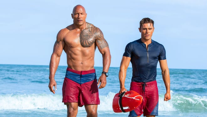 Dwayne Johnson, left, and Zac Efron are hard-bodied lifesavers in the comedy 'Baywatch.'