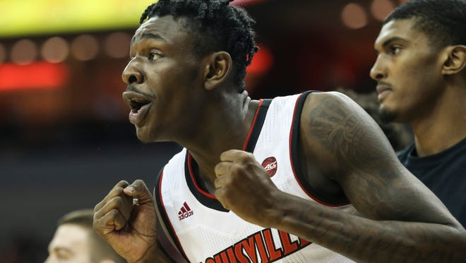 U of L's Lance Thomas cheers on his teammates during the second half against the visiting Siena Saints on Wednesday evening at the KFC Yum Center. U of L came on strong in the second half to take an 86-60 victory. Dec. 6, 2017