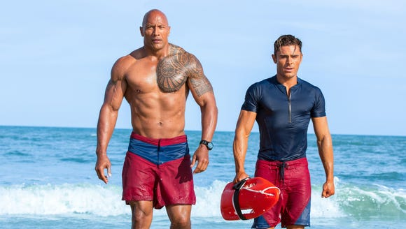 Dwayne Johnson (left) and Zac Efron hit the beach for