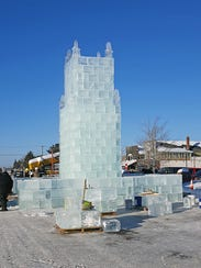 Volunteers work to build the Eagle River ice castle