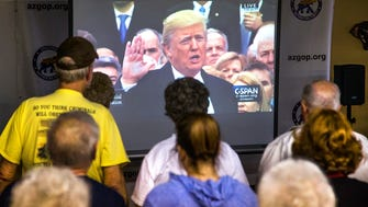 Donald Trump supporters pack the Arizona Republican Party office in Sun City as they watch the inauguration of the 45th president of the United States via a live television feed on Jan. 20, 2017.