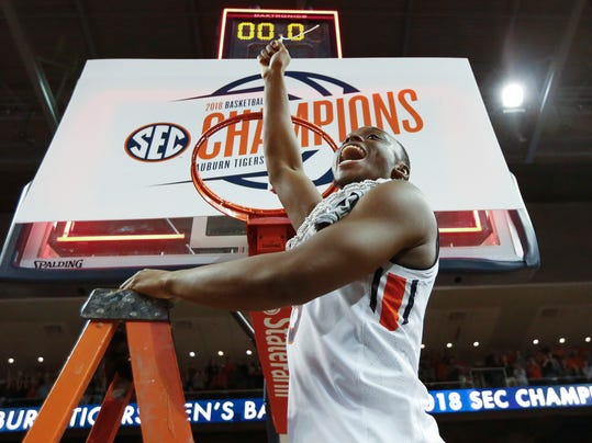 Auburn guard Mustapha Heron celebrates after cutting the net after an NCAA college basketball game against South Carolina, Saturday, March 3, 2018, in Auburn, Ala. (AP Photo/Brynn Anderson)