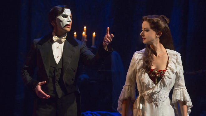 """Chris Mann as The Phantom and Katie Travis as Christine in the national touring production of """"The Phantom of the Opera,"""" coming to ASU Gammage May 27, 2015."""