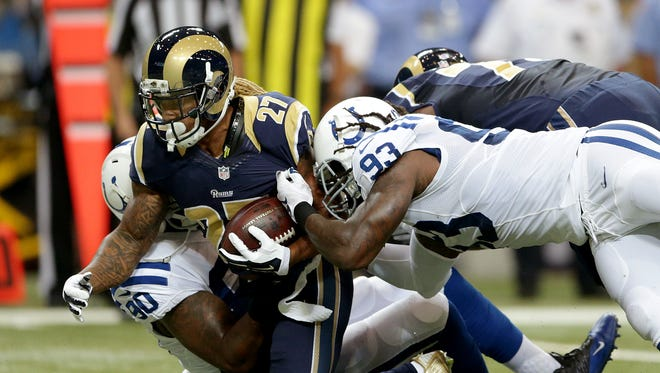 Indianapolis Colts outside linebacker Erik Walden (93) and Kendall Langford (90) team up to tackle St. Louis Rams running back Tre Mason (27) in the first half of their game Saturday, August 29, 2015, evening at the Edward Jones Dome in St. Louis MO.
