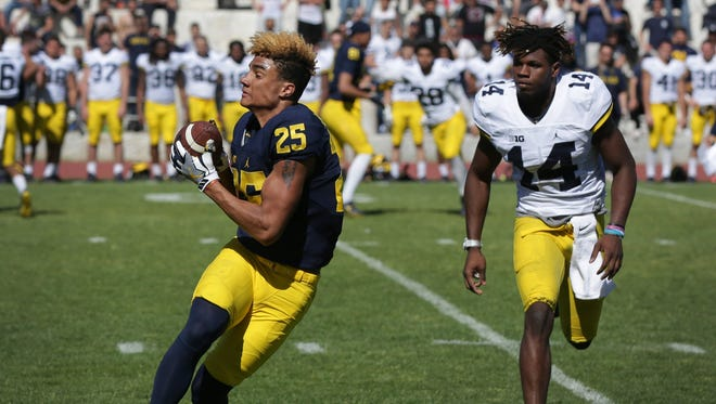 Michigan's Nate Johnson catches the ball against Josh Metellus during the team's last practice at Stadio dei Marmi in Rome on April 29, 2017.