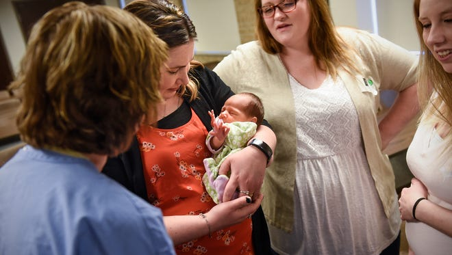 Catherine Waldoch holds her baby, Vanessa, during an interview with friends Renee Gonzales, Korissa Glynn and Holly Sibicky Friday, May 4, at St. Cloud Hospital.