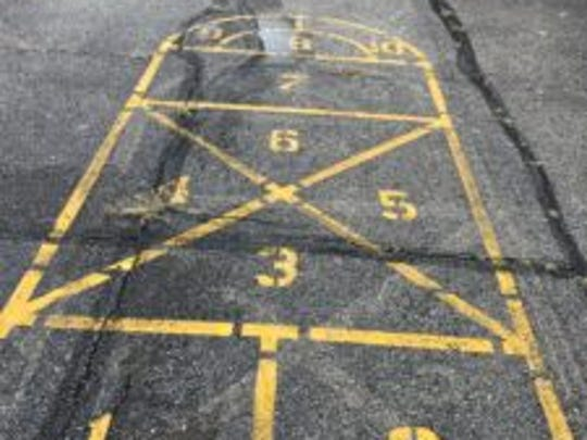 Children playing hopscotch at the Hyde Park School