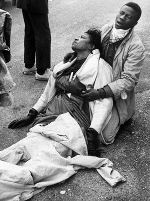 A civil rights marcher suffering from exposure to tear gas holds an unconscious Amelia Boynton Robinson after mounted police officers attacked marchers on March 7, 1965, in Selma, Ala., as they were beginning a 50-mile march to Montgomery to protest race discrimination in voter registration.