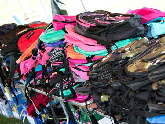 Backpacks await claiming during the 2015 Youth Impact