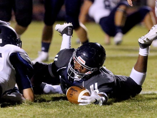 Siegel's Rodney Murray (4) dives into the endzone for