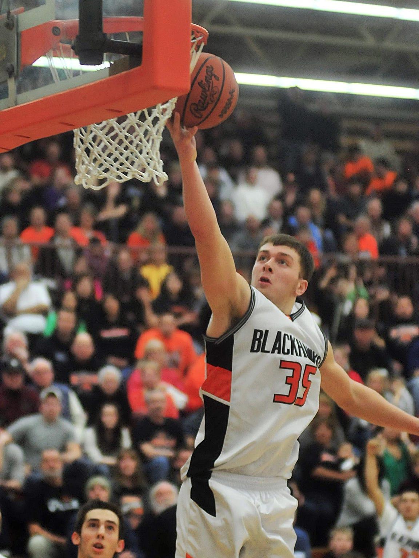 Fennville High School's Wes Leonard puts up the winning