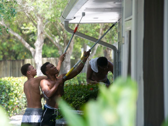 Lamont Toliver (left) and LaDarius Lyons, both 16 and