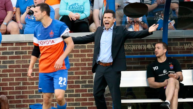 New FC Cincinnati head coach Alan Koch shouts from the sideline in the first half.