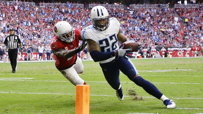 Tennessee Titans runningback Derrick Henry scores a touchdown past Arizona Cardinals Patrick Peterson in the first half on Dec. 10, 2017 at University of Phoenix Stadium in Glendale, Ariz.