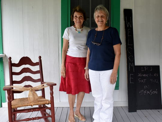 Laura Riding Jackson Foundation President Marie Stiefel with board member Susan Boyd on the front porch of the 1910 Florida Cracker House, recently named by The Florida Trust for Historic Preservation as one of 11 structures to preserve.