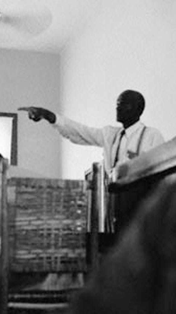 Mose Wright, Emmett Till's great-uncle, took the witness