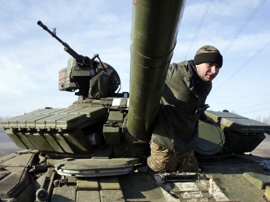 A Ukrainian serviceman climbs out of a Ukrainian army