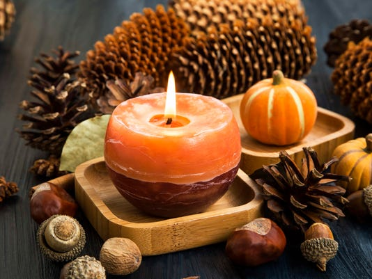 Autumn candle decoration with cones, acorns,anise and pumpkins