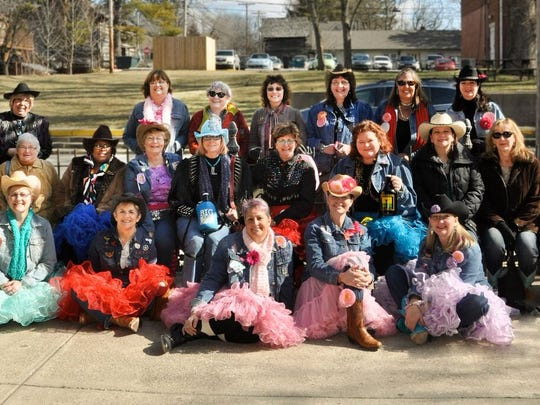 Rhonda Gelstein and a group of her friends pose in cowgirl hats and tutus at a Sisters on the Fly trip in 2015.