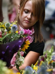 The Farmers Market at the Capitol will be held July 25, Aug. 22 and Sept. 19. In this file photo, a woman shops for flowers sold at the market.