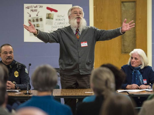 Craig Smith of Valley Vista, a drug and alcohol rehabilitation center in Bradford, speaks during a community meeting to discuss opiate addiction and its consequences at Camels Hump Middle School in Richmond on Wednesday.