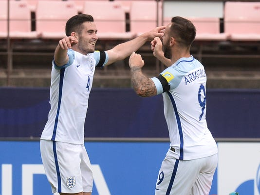 England's Lewis Cook, left, celebrates with his teammate Adam Armstrong after scoring a goal against Guinea during their Group A match in the FIFA U-20 World Cup Korea 2017 at Jeonju World Cup Stadium in Jeonju, South Korea, Tuesday, May 23, 2017. (Choi Jin-suck/Newis via AP)