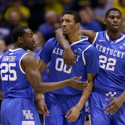 Kentucky's Alex Poythress (22), Marcus Lee (00) and