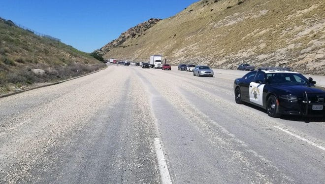 The California Highway Patrol was assisting with road traffic on eastbound Highway 118 near Simi Valley where gravel was dumped across the roadway.