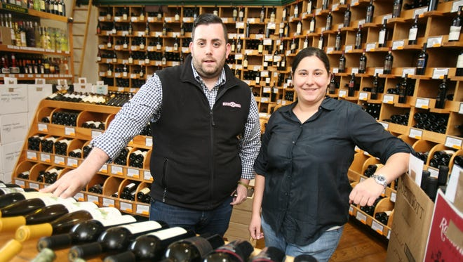 J.J. Berlingo, the wine consultant and Tracy Maxon, whose family owns the business, are pictured amongst the wine racks at their store, Varmax Liquor Pantry in Port Chester.