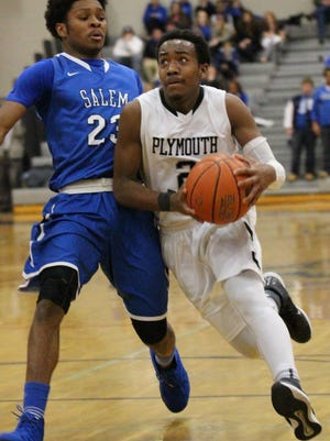 Plymouth senior Randall Aikins (right) makes a move against Salem defender Calin Crawford.