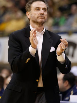 Louisville coach Rick Pitino works the court during a game against Pitt on Sunday in Pittsburgh.