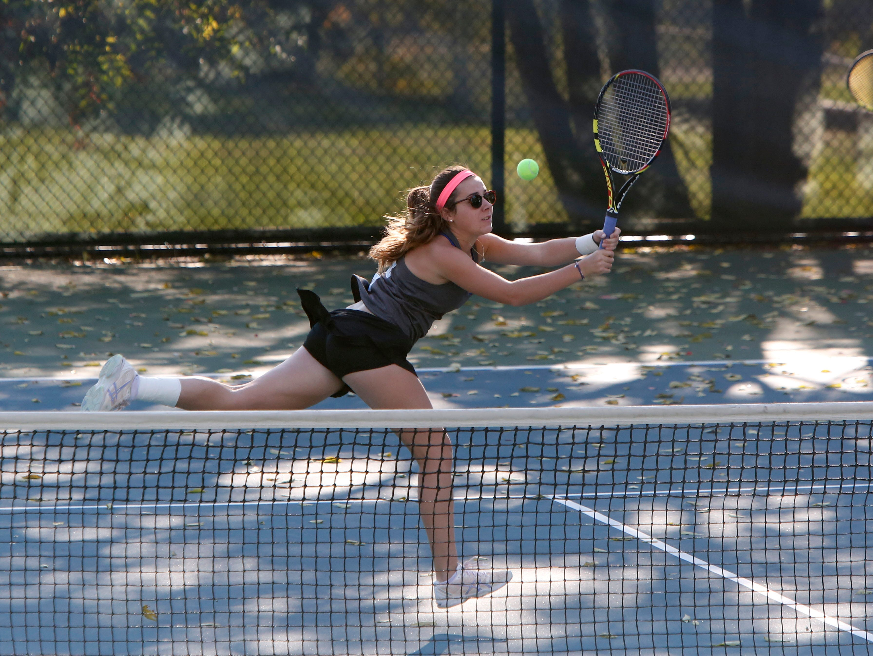 Rye Neck's Clemence Balzano returns the ball as teammate Mizuki Shionoya looks on in a doubles match against Bronxville's Katharine Frost and Eva Dani during the Conference III tennis tournament Oct. 15, 2015 at Edgemont High School in Scarsdale.