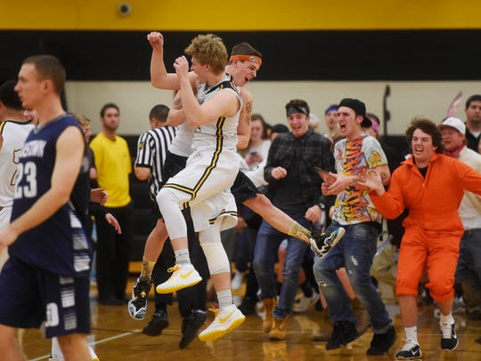 Red Lion fans charge the court after winning the boys'