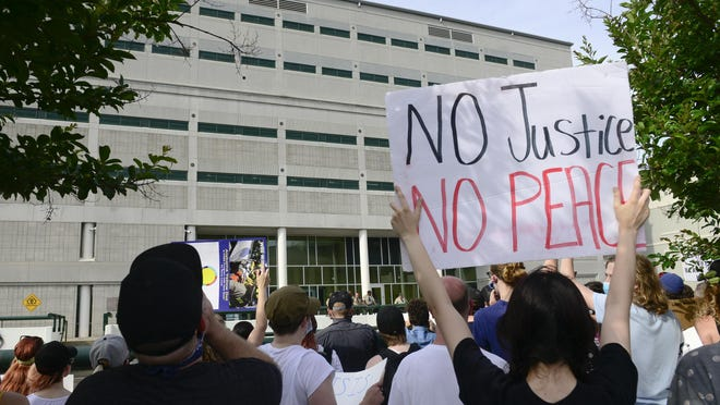 Protesters stand and chant outside the Etowah County Detention Center during a Black Lives Matter march in Gadsden on Sunday.