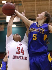 Bloomfield's Mattie Waresback blocks a shot by Shiprock's Shontai Grey in the first half Friday at the Chieftain Pit.