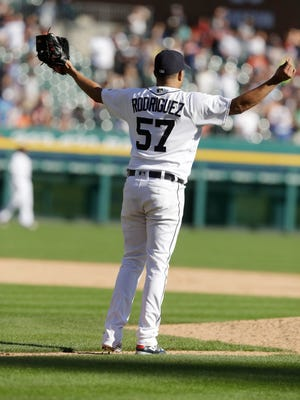 Detroit Tigers relief pitcher Francisco Rodriguez looks towards the outfield as two runs score during the ninth inning.