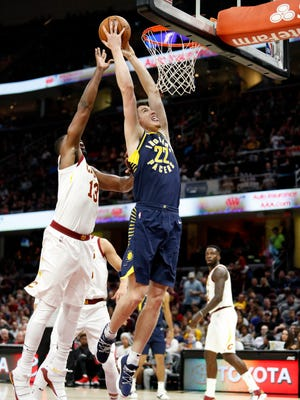 Pacers forward T.J. Leaf (22) goes up for a shot against Cleveland Cavaliers center Tristan Thompson (13) during the second quarter at Quicken Loans Arena.