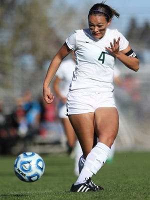 Farmington's Arin Coleman attempts a shot against Valencia in first half of Thursday's 5A state quarterfinals match in Bernalillo. The Lady Scorpions won, 6-0.