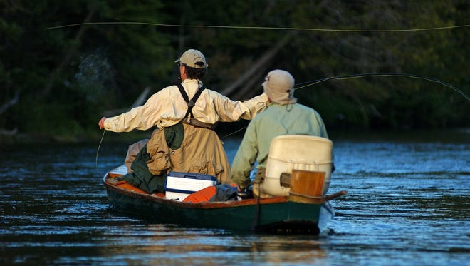 Fly fishing on the Au Sable is big business in the northern Michigan city of Grayling. The local economy largely depends on anglers.
