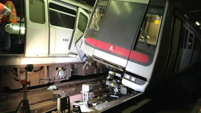 In this photo released by MTR Corporation, two MTR trains sit after collision on the Tsuen Wan Line during testing of the rail company's new signal system in Hong Kong Monday, March, 18, 2019.
