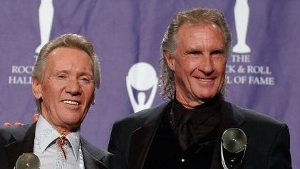 "Righteous Brothers, Bill Medley, right, and Bobby Hatfield pose for photographers after they were inducted into the Rock and Roll Hall of Fame on March 10, 2003. Hatfield died later that year. The duo's song ""You've Lost That Lovin' Feelin'"" has been selected for preservation at the Library of Congress."