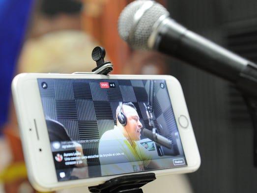 Luis Villanueva, a DJ for Radio Indîgena, goes live