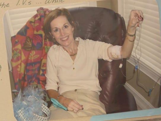 Kelly Deushane holds an IV.