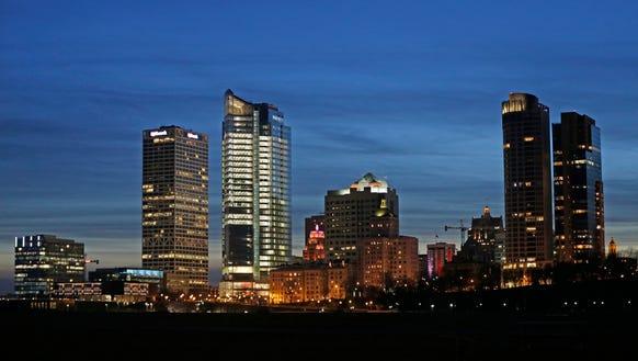 The sun sets behind the Milwaukee skyline on Sunday,
