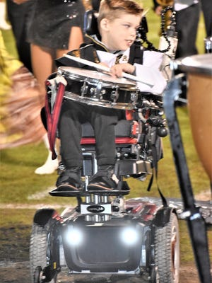 The Richmond Hill Wildcat Marching Band grew by one during the Wildcats 55-7 win over South Effingham on Nov. 13. Griffin Reeder, who has cerebral palsy, was made an honorary band member in the percussion section. Griffin looked every bit the part, dressed in a band  uniform, and was all smiles as he played along. Griffin is the son of Stephanie Reeder.
