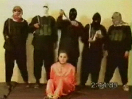 Nick Berg as seen in a video posted Tuesday May 11, 2004 on an Islamic militant web site affiliated with al-Qaeda. Berg's body was found in Baghdad, Iraq three days earlier.