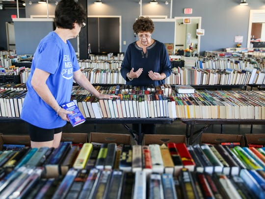 Mollye Swirsky and Linda Knightstep organize the books