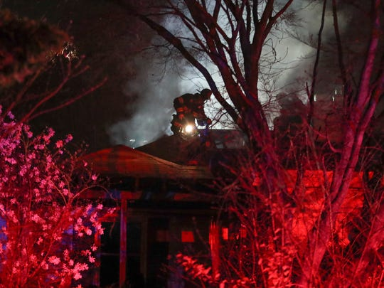 Firefighters work at the scene of a house fire on Chestnut Avenue in Roseville Park, near Newark, reported about 8 p.m. Thursday. One victim, a 66-year-old man, was taken to Christiana Hospital with burns and smoke inhalation.