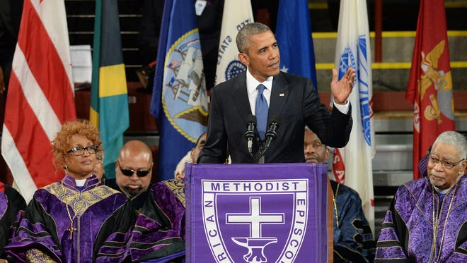 President Barack Obama gives the eulogy for State Senator Clementa Pinckney during his funeral service Friday, June 26, 2015 at the TD Arena on the campus of the College of Charleston.